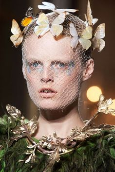 CHASING BUTTERFLIES  Iridescent eyes glittered against netted face coverings at Giambattista Valli.