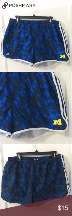 """Adidas University of Michigan Running Shorts XL Perfect shorts for running! Includes a breatheable """"underwear"""" layer that provides modesty and wicks away sweat. Internal drawstring and a waterproof outer shell with a cute U of M logo on the front. Adidas Shorts"""