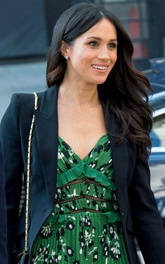 Prince Harry, Meghan Markle, Invictus Games Reception, Australia House, London, England - Markle, 36, looked radiant in a forest green flowy dress, which she paired with a black jacket and matching heels. She previously wore the blazer in February to the Endeavour Fund Awards, her first official event she attended with her husband-to-be after they announced their engagement.