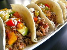 Spiced ground pork tacos with sweet n' spicy, bell pepper avocado salsa and Cotija cheese