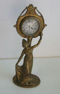 Antique German Miniature Doll House Gilt metal Art Nouveau clock.  3 1/4 x 1 1/8.  Has a glass bezel face. c1890-1910.