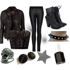 Leather jacket, leather pants, and a stunning bustier top, paired with a skull ring, studded earrings, and black nail polish-pure sexiness. I would add heels and omit the spiked choker.