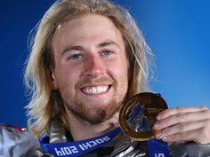 Gold medalist Sage Kotsenburg of the United States celebrates during the medal ceremony for the Snowboard Men's Slopestyle during day 1 of t...