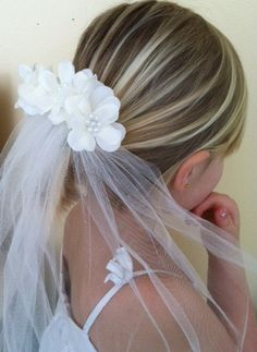 First Communion Veil with Comb (available in white or ivory with options of pearl or bead center) on Etsy, $30.70 CAD