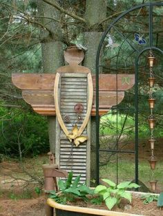 This is cute!...I love the mixture of Found Objects to create an Angel!....kudos to the creator--great artistic eye!....