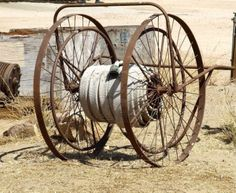 Antique fire hose hand cart used at old railroad yard Stock Photo