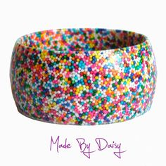 Rainbow Resin Bangle - Bracelet - Hundreds and Thousands - Cake Sprinkles - Colourful Bright Sweets - Candy. £25.00, via Etsy.