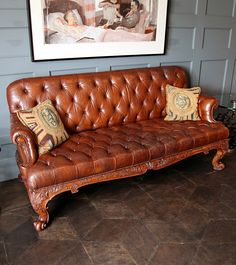 Continental Leather and Carved Wood Chesterfield Sofa