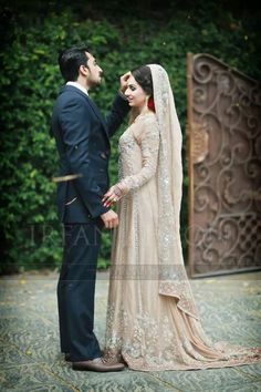 Pakistani bride and groom,  Lovely Dress in just US$1350 + FREE Stitching Charges = US$1350  Email us order at hoor@pkbridal.com Join viber at +923332469680