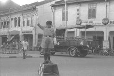Policeman directing traffic in 1968 at Joo Chiat Road/Geylang Serai junction.