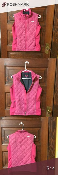 Northface vest Northface vest size medium. Raspberry pink color quilted in front and stretchy fabric on sides of vest  quilted in back of vest except for sides where there is a stretchy fabric. Gray on the inside there is an inside pocket right side. Zippered pocket on each side of vest   This is an used vest that has been well loved. northface Jackets & Coats Vests