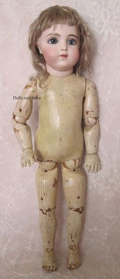 Very Rare French Bisque Bebe Modele by Bru with Wooden-Articulated from dollsandlace on Ruby Lane