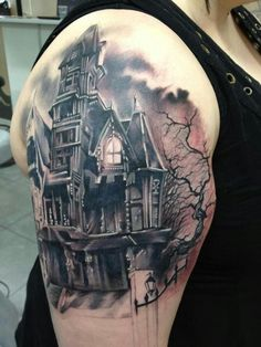 Barren Castle with evil Shadow. If you have body with abs and muscles, then this castle tattoo is worth trying, as it requires a room to get covered.