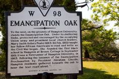 hampton university pics   The Emancipation Oak is visible to the right of the sign.