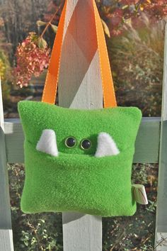 Tooth Fairy Pillow- to hang on the door.  But change the design so it does not look like a monster pillow