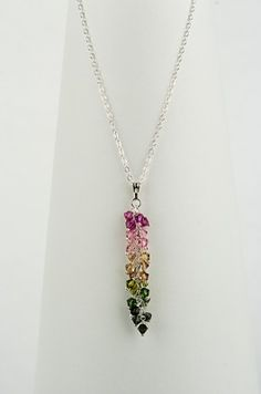 Necklace made with Swarovski bicone beads, sterling silver wire and sterling silver chain.