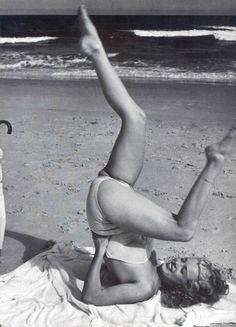 Wacky beach exercising! [1949 by André De Dienes]