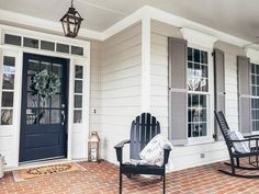 Navy blue front door color is Charcoal Blue in Satin by and pairs nicely with Benjamin Moore Revere Pewter siding and Graystone shutters. Trim and blue porch ceiling is Sherwin Williams pearly white and misty. House Shutters, House Siding, Painted Front Doors, Exterior House Paint Color Combinations, House Exterior, Exterior Design, House Painting, Shutter Colors, House Paint Color Combination