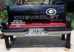 my awesome parents made me this bench with a chevy tailgate, and a bumper. painted in my fav sports colors for UGA! added a magnet to show my bulldog pride! LOVE IT!!!