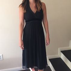 Black formal dress with bead detail. Perfect for any formal event! This is a petite size however it is still long on me and think would look good on someone taller. Dresses