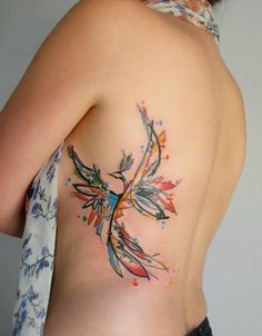 Full back phoenix with flower tattoos on girl looking beautiful.
