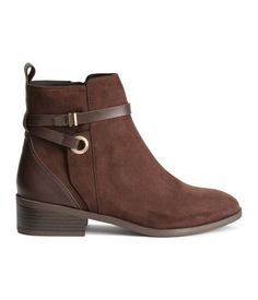 Dark brown. Jodhpur boots in imitation suede with imitation leather details, decorative straps with metal buckle, and zip at side. Satin lining, imitation