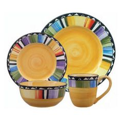 Fandango 16-Piece Dinnerware Set. Enjoy vibrant colors with this bold Home Fandango The stoneware dinnerware set provides service for four with its four dinner plates, four salad plates, four bowls and four mugs. The stoneware is microwave-safe as well as dishwasher-safe.Home Fandango 16-Piece Dinnerware Set with Service for four:* Four dinner plates* Four salad plates* Four bowls* Four mugs* Microwave-safe* Made of stoneware* Dishwasher-safe