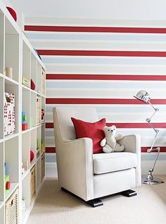 I'd really love to do stripes in Cub's room--I like the soft colors here with the red. Hmm...