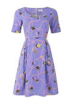Make a statement in this fabulous dress by fashion designer Zandra Rhodes for People Tree. The dress has a tailored, high-waisted fit and features Zandra's bold signature lilac jungle trail print.