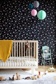 Wall paper or fabric on wall. I don't know or care, but I'm in love with that print!    Oeuf NYC nursery.