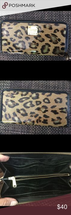 Lauren RL leopard print wallet Leopard print pleather outside. leather inside gold tone hardware.gold logo on front zip pocket inside middle.gold zipper closer bought at Macy's at Christmas. Nice size perfect condition Lauren RL Bags Wallets