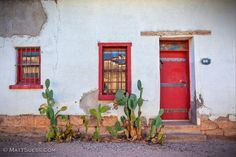 These Red Windows And Door With Cactus In The Foreground Was Photographed  In December Of 2011 Near The Tucson Barrio District.