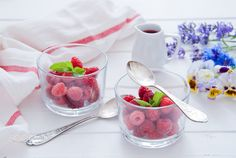 Fresh Organic Raspberries for Breakfast on white wooden background