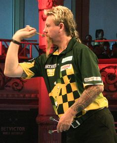 Simon Whitlock in action during his first round clash with Jelle Klaasen