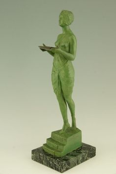 Art Deco sculpture of a woman holding a tray by Pierre Le Faguays. image 2
