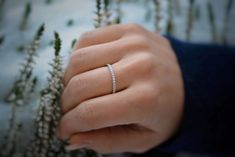 A stunning half eternity diamond band in solid 14K gold that is perfect alone or for stacking with your other rings