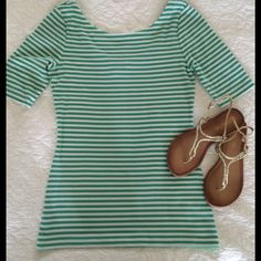 Banana Republic Striped Wide-Neck Tee Chic Striped Tee with low back and wide neckline.  Has nifty snaps on shoulder seams to keep bra straps in place.  Looks great with white jeans or skirts! Banana Republic Tops Tees - Short Sleeve