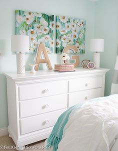 Sophisticated teenage girls bedroom makeover. Gorgeous white dresser + canvas paired wall art from HomeGoods. Lamps from Target