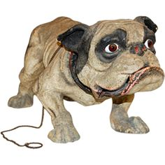 """French 19th Century Papier Mache """"Growler"""" Toy on Wheels  France  19th Century  French 19th Century Growler Dog on Wheels with glass eyes and leather collar."""