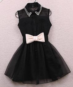 Black dress with a cute white now like a girls dress tuxedo.