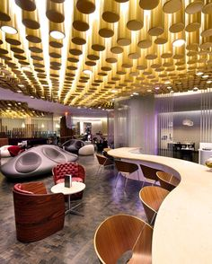 A cloud-like structure of stainless steel rods encloses a cocktail bar and several seating areas at JFK Airport's Virgin Atlantic Clubhouse by @sladearchitecture. Views of Eero Saarinen's iconic TWA terminal lend a subtle 1950s glamour to the design. : Anton Stark. #architecture #hotel #interior #design #interiordesign #lounge #jfk #airport #modern #nyc... - Interior Design Ideas, Interior Decor and Designs, Home Design Inspiration, Room Design Ideas, Interior Decorating, Furniture And…