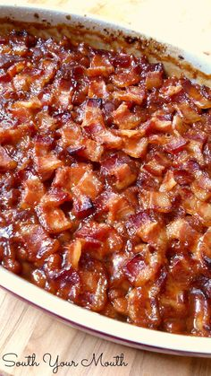 A classic Southern-style baked beans recipe made with brown sugar topped with bacon. Southern-Style Baked Beans - South Your Mouth: Southern Style Baked Beans Baked Beans With Bacon, Pork N Beans, Southern Baked Beans, Easy Baked Beans, Baked Beans Crock Pot, Homemade Baked Beans, Baked Beans Recipe Brown Sugar, Grandma Browns Baked Beans Recipe, Baked Pork And Beans Recipe