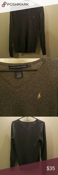 Gray merino wool Polo sweater V neck gray wool sweater. Has gone through dryer but still fits like a medium.  No pills Polo by Ralph Lauren Sweaters V-Necks