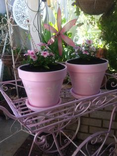 I painted these pots up pink and did some stenciling on them to bring some more pinkness outside =)