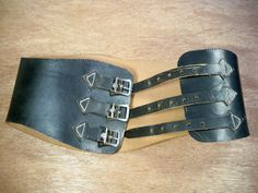 Up on ETSY for buy it now is a pair of good condition, Vintage Buco Made in USA Black Leather Motorcycle Biker Riding Chopper Kidney Belt. Size 28.