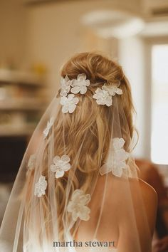 Though flowers are a popular veil component, these oversized, Hawaiian-inspired floral appliqués feel decidedly new-age—especially when place below a messy, voluminous bouffant. #weddingideas #wedding #marthstewartwedding #weddingplanning #weddingchecklist Blue Wedding Dresses, Wedding Gowns, Bridal Veils, Bridal Hair, Wedding Garters, Lace Wedding, Wedding Bride, Civil Wedding, Dream Wedding