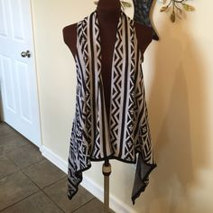 Aztec high low kimono In style black and white Aztec print sleeveless kimono. Perfect for skinny jeans, leggings, and boots! Loose fitting. Excellent condition! Gathered back.  100% acrylic. Offers accepted. Please use the offer button. United States Sweaters Sweaters