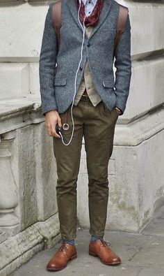 Shop this look for $315:  http://lookastic.com/men/looks/blazer-and-waistcoat-and-socks-and-derby-shoes-and-dress-shirt-and-scarf-and-backpack-and-chinos/627  — Navy Wool Blazer  — Tan Waistcoat  — Blue Socks  — Brown Leather Derby Shoes  — White and Blue Vertical Striped Dress Shirt  — Burgundy Scarf  — Dark Brown Leather Backpack  — Olive Chinos