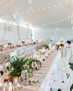 Jola designed the look for the reception decor, which included hanging dream catchers made by Lucyna Bielat and Claire Roudabush. Fern centerpieces were placed down the centers of the long tables.