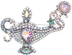 """Kirks Folly  VINTAGE MAGIC DUST GENIE LIMITED EDITION LAMP PIN  #7 of 300 #KirksFolly  The top, bottom and tip of the lantern  have large marquise shaped  aurora borealis crystals and the center of the lamp has an aurora borealis crystal heart.   Rising from the tip of the lamp is an aurora borealis Seaview Moon Genie surrounded by pink crystals.  Silvertone Measures approximately 4"""" x 3-1/2"""""""